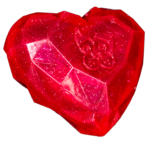 Squeaky Gems Heart is red and shaped like a brilliant cut gem