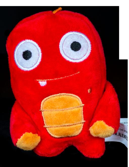 Mini Stixx Alien Flex Plush is red with orange accents on the body